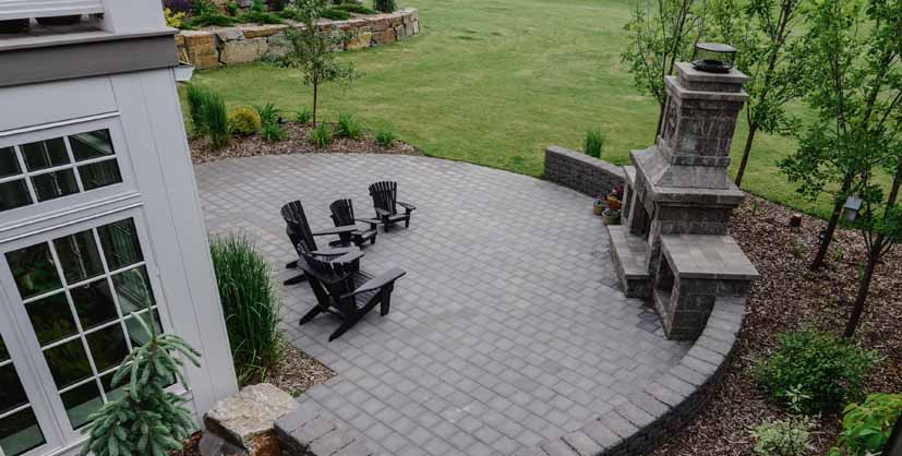Backyard Circle Patio with Fireplace and Chairs