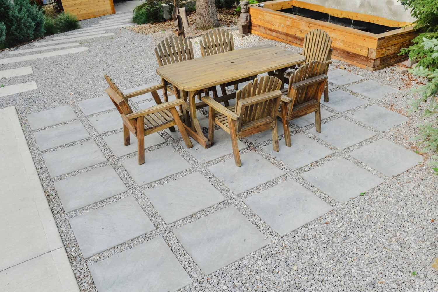 Square Stone and Gravel Patio with Seating