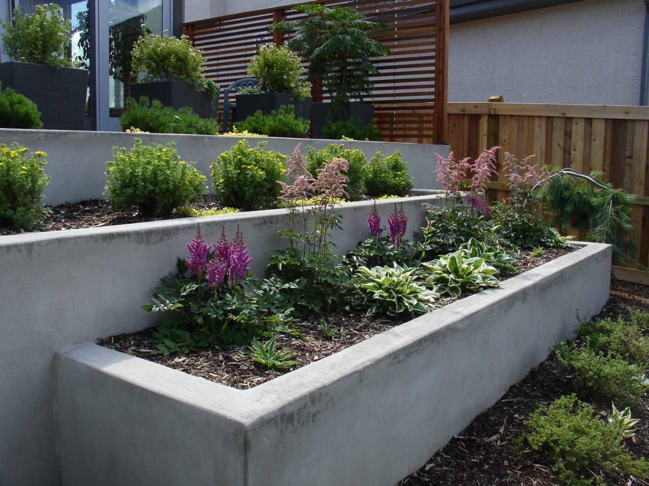 Solid Retaining Wall with Garden - Edmonton Landscaping