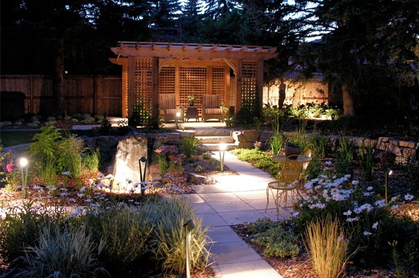 Intimate backyard with lighting at night