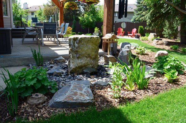 Stone Patio and Boulder in Landscaping - Salisbury Landscaping Project
