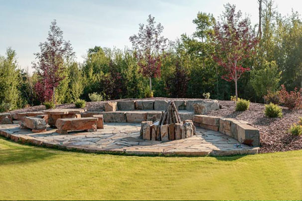 Stonework Boulders Patio and Firepit in Landscape Design - Salisbury Landscaping project