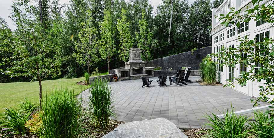 Backyard with stone fireplace, patio and trees