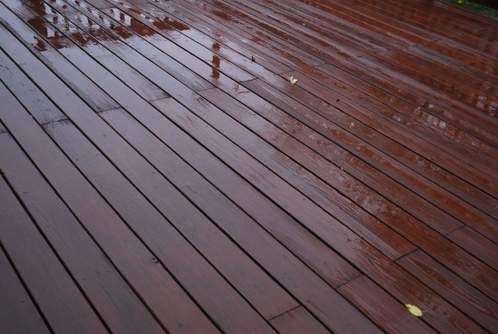 Pressure wash and seal decking.
