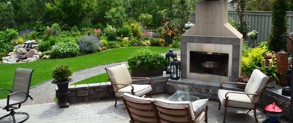 outdoor fireplace with seating area Salisbury Landscaping