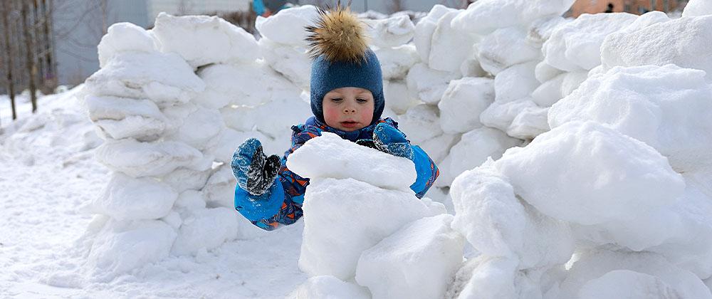 child building snow fort