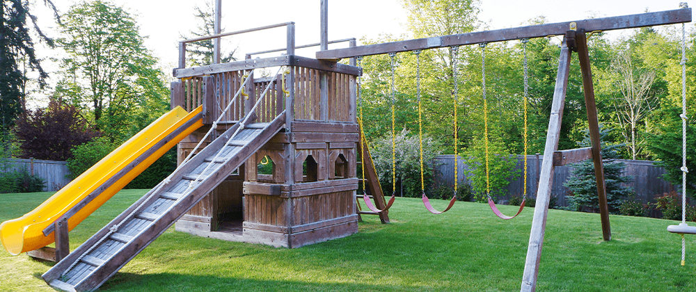 childrens play structure in back yard