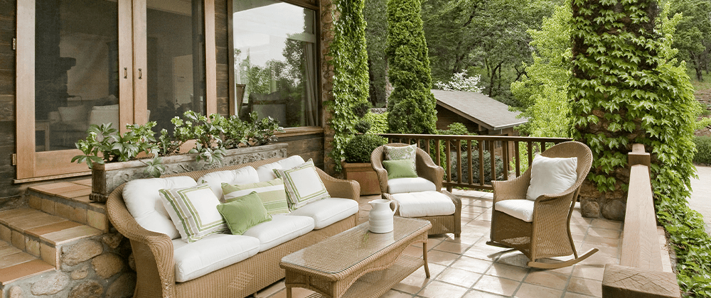 matching patio furniture on front deck of home