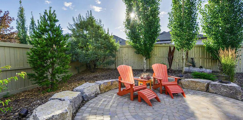 red Adirondack chairs backyard landscape Salisbury Landscape