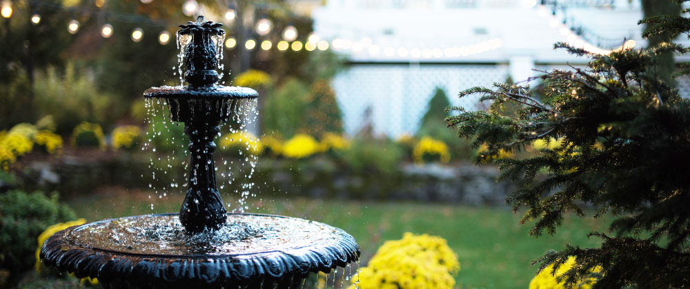 tiered water fountain in backyard Salisbury landscaping
