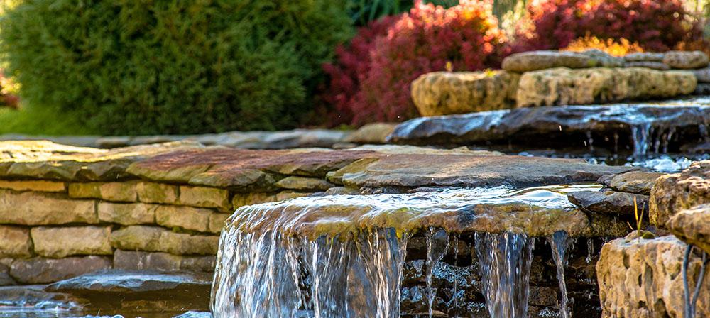 rustic water landscape feature rock waterfall